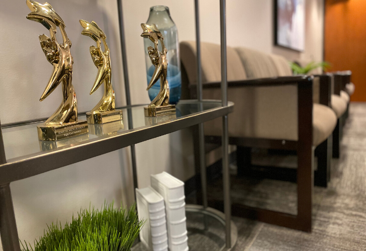 Photo of trophies displayed on shelf in Suite 301 lobby